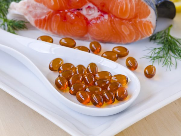 Omega 3 fish oil tablets. Dietary supplements. Selective focus. Taken in daylight.