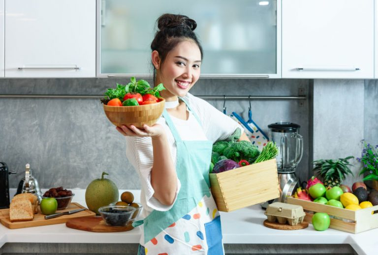 Woman smiling in the kitchen