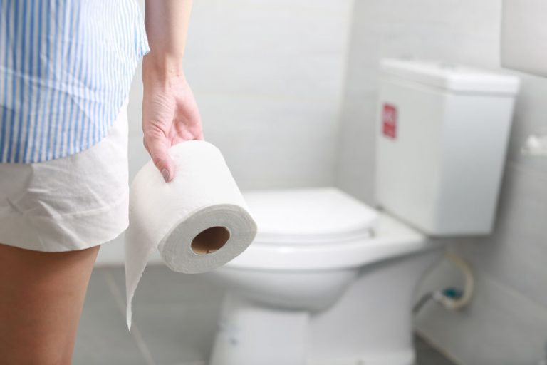 Woman with roll of toilet paper