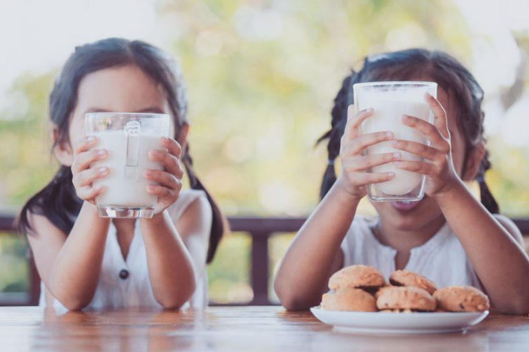 Young girls drinking milk